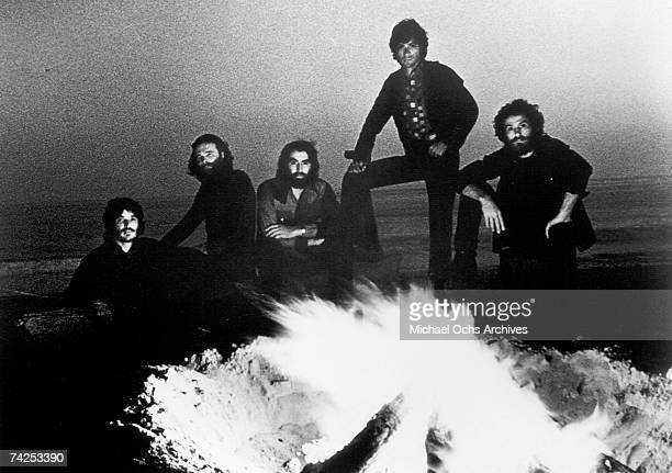 Rock group The Band pose for a portrait by a camp fire in circa 1972 Rick Danko Garth Hudson Richard Manuel Robbie Robertson Levon Helm