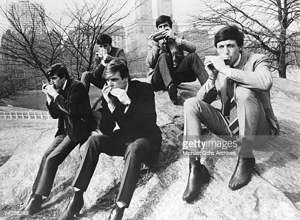 "Rock group ""The Dave Clark Five"" play harmonicas in the park in circa 1963. Rick Huxley, Denis 'Denny' Payton, Lenny Davidson, Dave Clark, Mike Smith."
