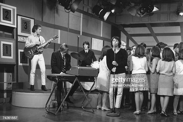 Rock group The Doors LR Robby Krieger Ray Manzarek John Densmore and Jim Morrison perform on 'Boss City' on KHJTV on May 15 1967 in Los Angeles...
