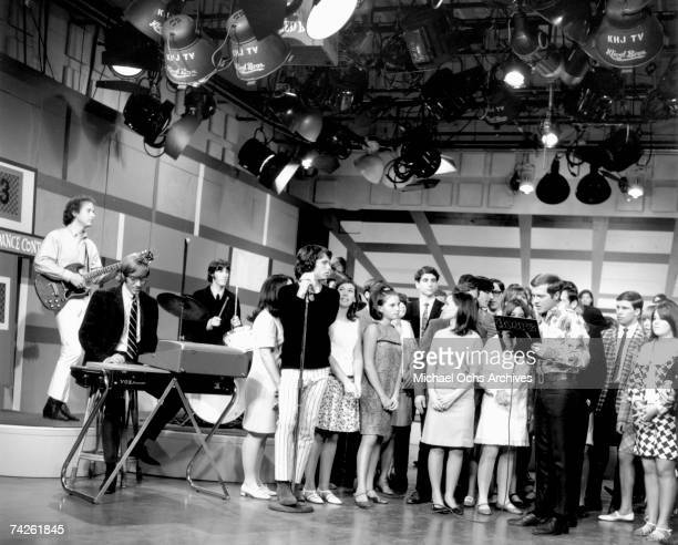 Rock group The Doors (L-R Robby Krieger, Ray Manzarek, John Densmore and Jim Morrison perform on 'Boss City' on KHJ-TV on May 15, 1967 in Los...