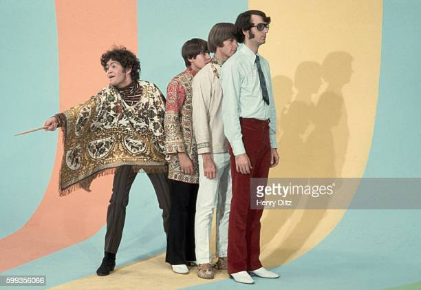 Rock group The Monkees performing a dance number for their television show by a striped wall