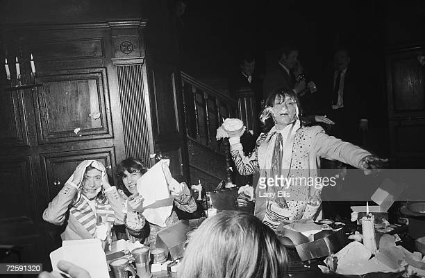 Rock group The Rolling Stones throwing food in the Elizabethan room at the Kensington Gore hotel where they hosted a banquet for the launch of their...