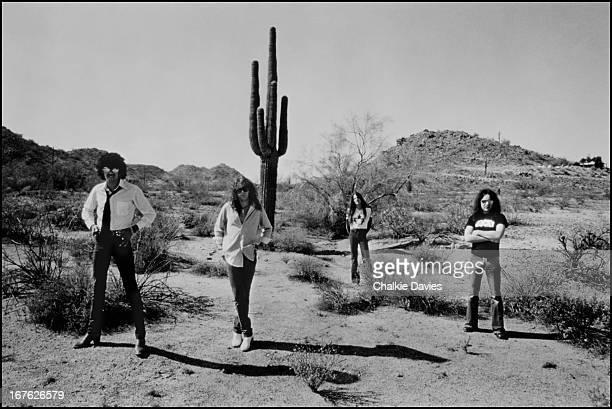 Rock group Thin Lizzy in the desert near Phoenix Arizona 1978 Left to right bassist and singer Phil Lynott guitarist Brian Robertson guitarist Scott...