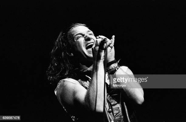 Rock group U2 performing on stage at the National Exhibition Centre in Birmingham Pictured is lead singer Bono 3rd August 1987