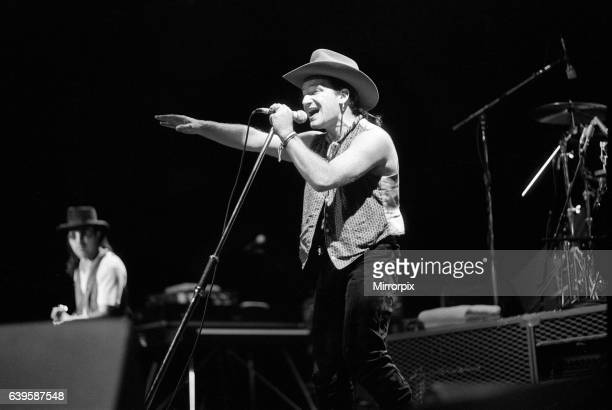 Rock group U2 performing on stage at the National Exhibition Centre in Birmingham Pictured is lead singer Bono 3rd June 1987