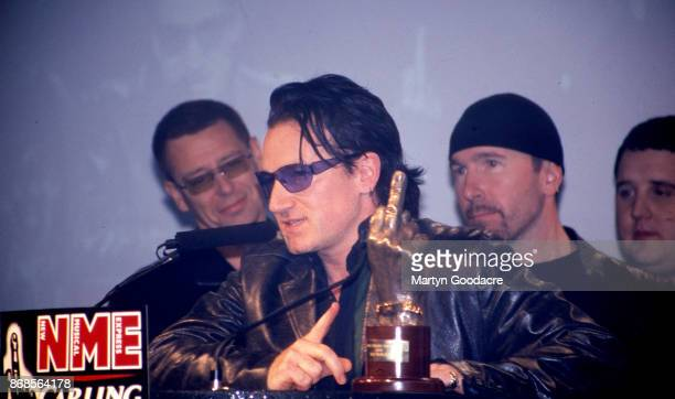 Rock group U2 winners of both 'Best Rock Act' and ' Godlike Genius' at the NME Awards Planit Arches London 6th February 2001
