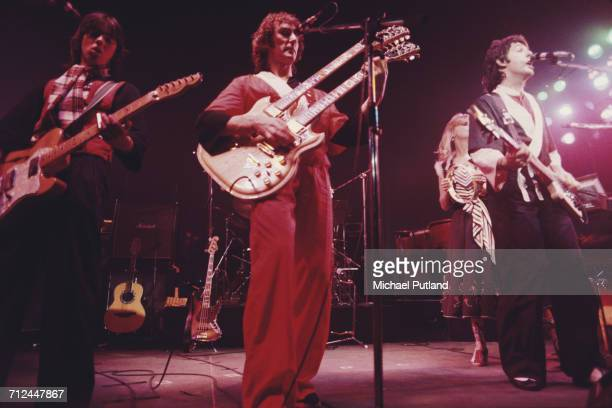 Rock group Wings perform live on stage on their Wings Over the World tour in March 1976 The band are from left to right Jimmy McCulloch Denny Laine...