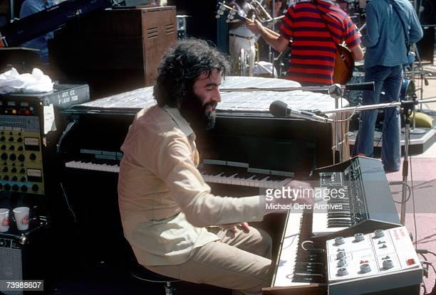 Rock group'The Band' performs outside onstage in June 1976. Garth Hudson, Richard Manuel, Levon Helm, Rick Danko, Robbie Robertson.
