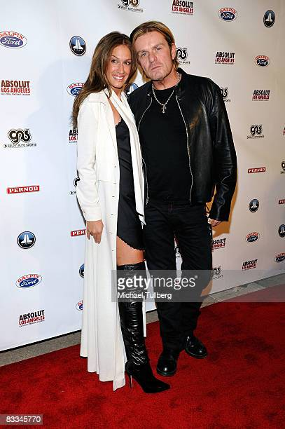 Rock guitarist Billy Duffy arrives with Angela Celi at the benefit grand opening of celebrity vehicle customization shop Galpin Auto Sports on...