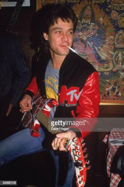 Rock guitarist Eddie Van Halen wearing an MTV jacket 1986