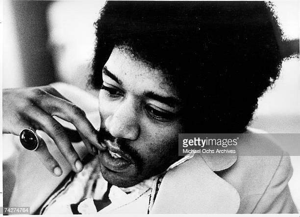 Rock guitarist Jimi Hendrix chews his nails in a candid moment in circa 1969