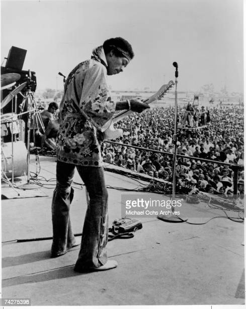 Rock guitarist Jimi Hendrix performs onstage in circa 1968