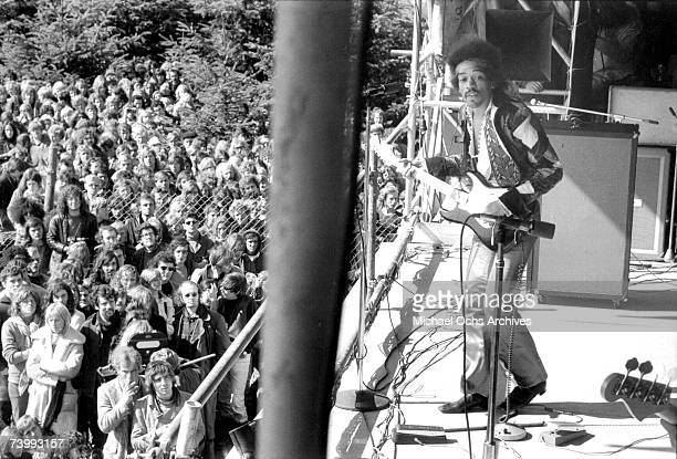 Rock guitarist Jimi Hendrix performs onstage with his Fender Stratocaster electric guitar at his last concert on September 6, 1970 in Isle of...