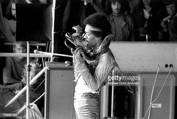 Rock guitarist Jimi Hendrix plays his Fender Stratocaster electric guitar with his teeth at his last concert on September 6, 1970 in Isle of Fehmarn,...