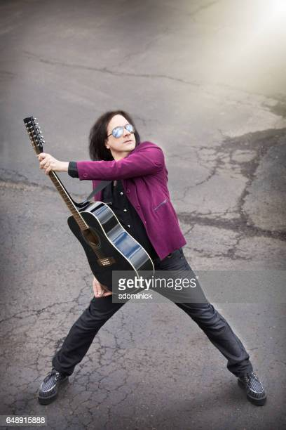 rock guitarist - guitarist stock pictures, royalty-free photos & images