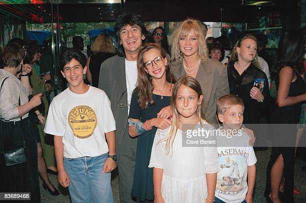 Rock guitarist Ronnie Wood with his wife Jo and their children at the London premiere of 'Wayne's World' 21st May 1992