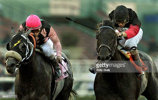 Rock Hard Ten with jockey Gary Stevens right beats Imperialism with Jockey Alex Solis by a nose in the Strub Stakes at Santa Anita Saturday