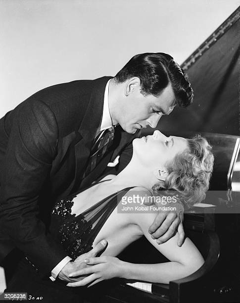 Rock Hudson and Cornell Borchers are overcome by passion on the keyboard of a piano in 'Never Say Goodbye', directed by Jerry Hopper.