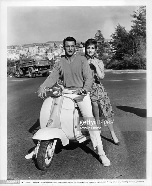 Rock Hudson and Gina Lollobrigida together on a motorscooter in a scene from the film 'Come September' 1961
