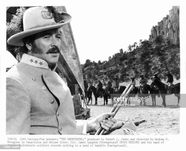 Rock Hudson and his band of former Confederate soldiers concede nothing to a band of bandits in a scene from the film 'The Undefeated' 1969