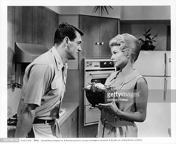 Rock Hudson and Mary Peach in the kitchen together in a scene from the film 'A Gathering Of Eagles' 1963