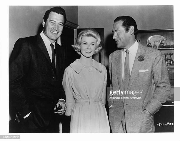 Rock Hudson, Doris Day and Rex Harrison standing together in a scene from the film 'Midnight Lace', 1960.
