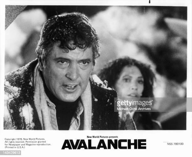 Rock Hudson drenched in snow in a scene from the film 'Avalanche' 1978