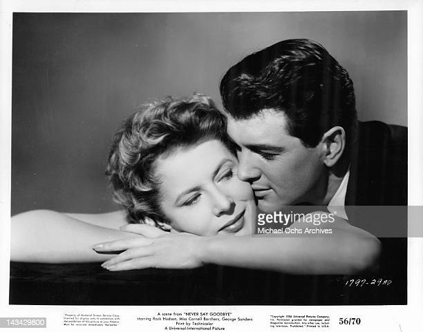 Rock Hudson has his lips on Cornell Borchers cheek in a scene from the film 'Never Say Goodbye', 1956.