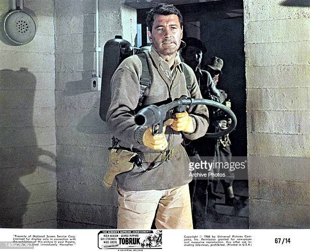 Rock Hudson holding flame thrower in a scene from the film 'Tobruk' 1967