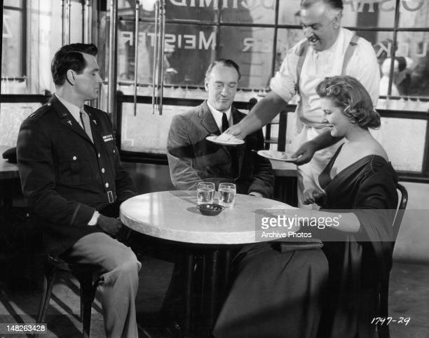Rock Hudson resents the intrusion of George Sanders while he is lunching with Cornell Borchers and are invited by Ray Collins to join him at his...