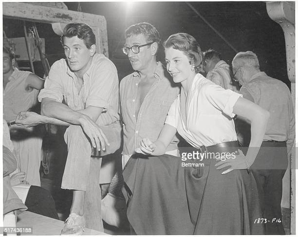 Rock Hudson Richard Haydn and Cyd Charisse on the set of Twilight for the Gods directed by Joseph Pevney
