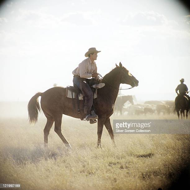 Rock Hudson US actor on horseback in a publicity still issued for the film 'Giant' 1956 The western directed by George Stevens starred Hudson as...