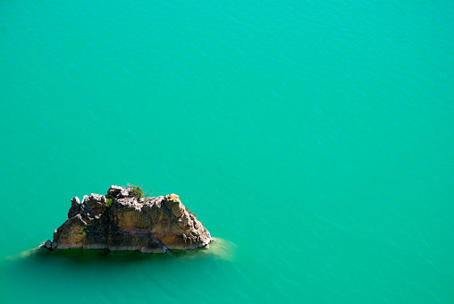 Rock in a Turquoise Lake - gettyimageskorea