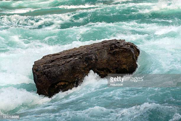 rock in rapids - furious stock pictures, royalty-free photos & images