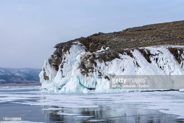 rock island in lake baikal, russia, landscape photography - frozen stock pictures, royalty-free photos & images
