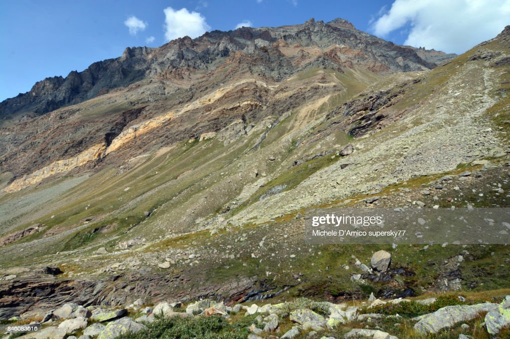 Rock layers on the slopes of Mt Grivola : Stock Photo