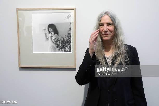 Rock legend and photographer Patti Smith is seen posing by the iconic picture that was featured on her 1979 album 'wave' during Paris Photo 2017 at...