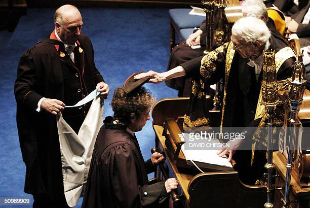 Rock legend Bob Dylan receives an honorary degree of Doctor of Music from Sir Kenneth Dover Chancellor at the University of St Andrews 23 June 2004...