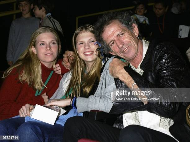 Rock legend Keith Richards huddles with his daughters Alexandra and Theodora at a Memorial SloanKettering Cancer Center benefit screening of the...