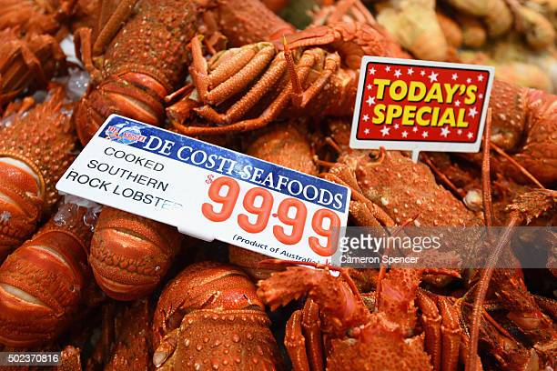 Rock lobsters are displayed as crowds gather for last minute shopping before Christmas at the Sydney Fish Market on December 24 2015 in Sydney...