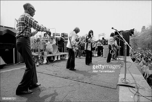 Rock music group Jefferson Starship along with guest Papa John Creach on fiddle perform in Central Park New York New York May 1975