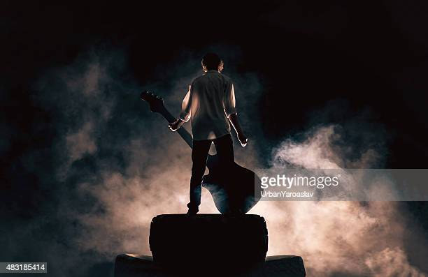 Rock musician and large guitar, a lot of smoke