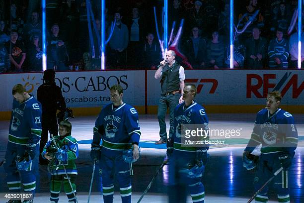 Rock musician Barney Bentall sings the national anthems as the Pittsburgh Penguins visit the Vancouver Canucks on January 7, 2014 at Rogers Arena in...