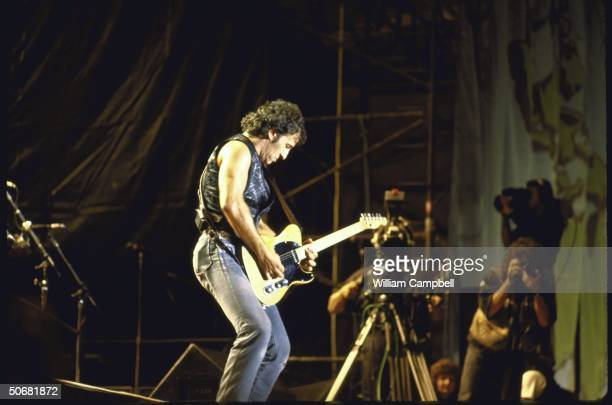 Rock musician Bruce Springsteen performing during Amnesty International's Human Rights Now concert tour