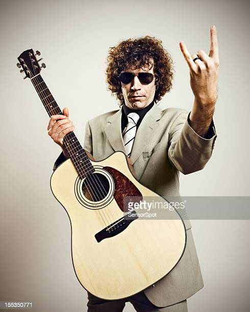 rock musician with guitar - early rock & roll stock photos and pictures