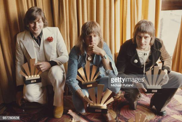 Rock musicians Greg Lake , Keith Emerson , and Carl Palmer, of the group Emerson Lake And Palmer receive their awards at the 1972 Melody Maker Pop...