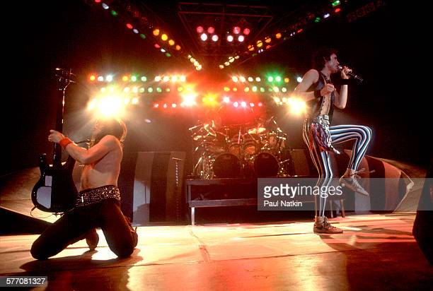 Rock musicians Rudy Sarzo and Kevin DuBrow both of the band Quiet Riot perform onstage Milwaukee Wisconsin January 14 1984 Visible in the center...