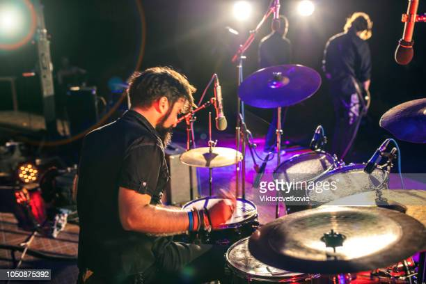 rock n roll drummer at the stage - drum kit stock pictures, royalty-free photos & images