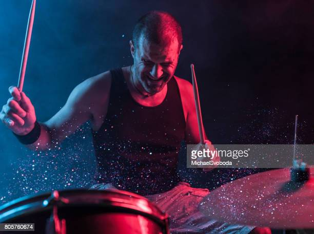 rock n roll drummer with sparkles coming off the drums - play off stock pictures, royalty-free photos & images