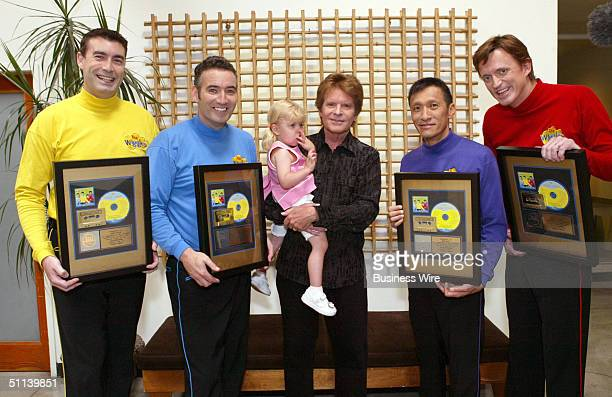 Rock 'n' Roll Hall of Famer John Fogerty poses for a photo as he congratulates preschool superstars The Wiggles on their first US Gold Album for...